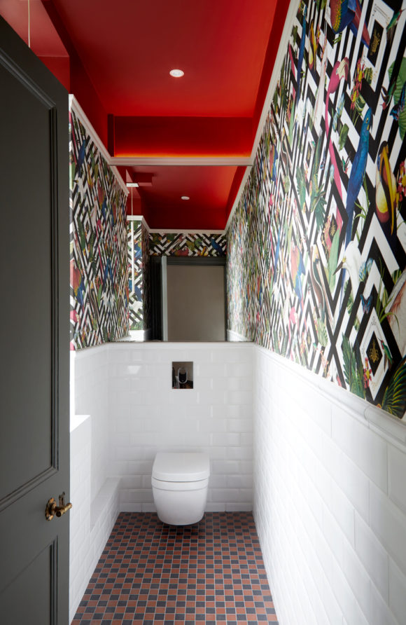 patterned wallpaper in cloakroom, red ceiling