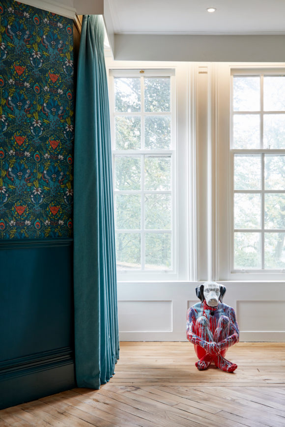 patterned wallpaper, green walls, dog art, bay window
