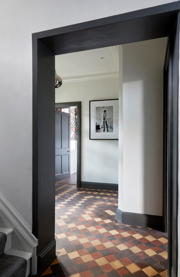 hallway with grey woodwork and tiled floor