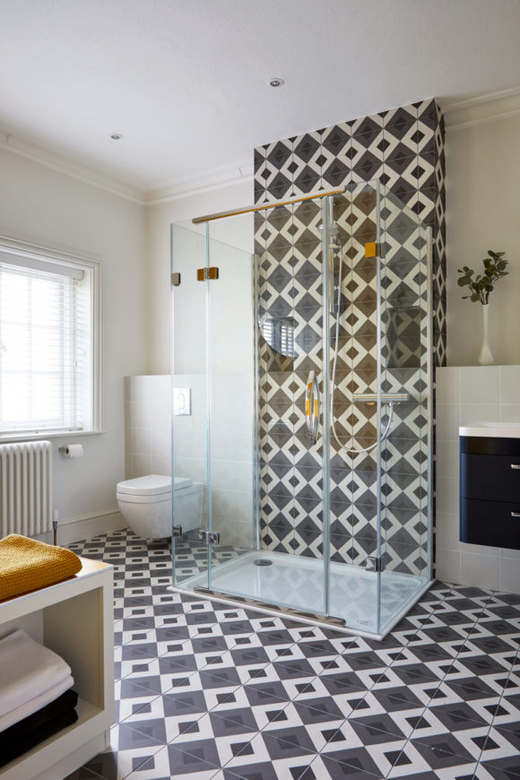 family bathroom with black and white tiles, shower cubicle
