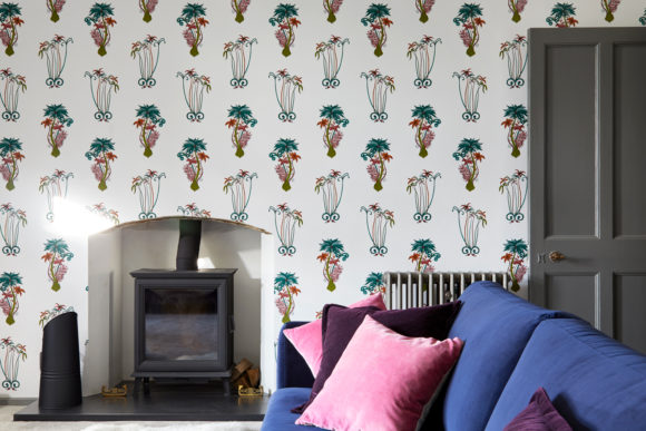 patterned wallpaper in sitting room, log burner, blue velvet sofa