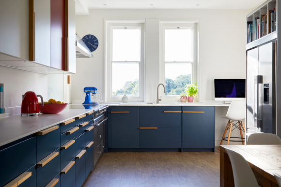 bespoke kitchen with blue cupboards